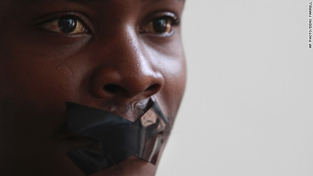 FEBRUARY 27 - JOHANNESBURG, SOUTH AFRICA: Television employee Zixolisile Mtebele protests against the December arrest of a team of Al Jezeera journalists in Egypt. The journalists remain in police custody along with 17 others. They have been charged with aiding or joining a terrorist group and are currently standing trial.