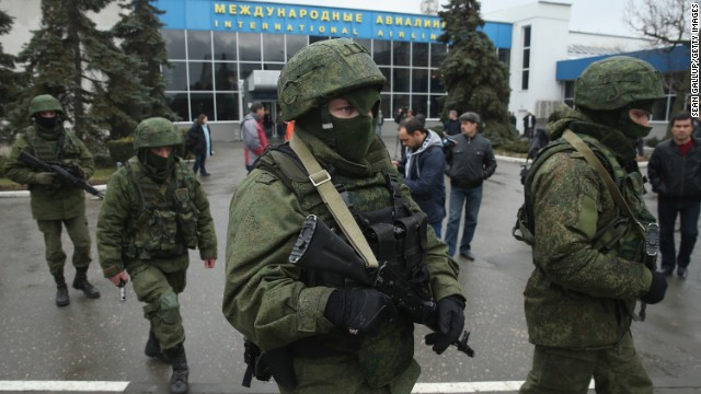 Armed men patrol outside the Simferopol International Airport on Friday, February 28.