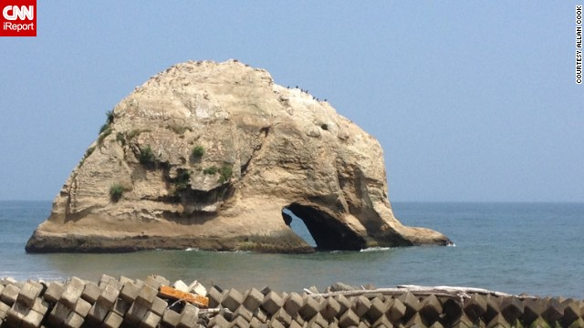 This <a href='http://ireport.cnn.com/docs/DOC-1039022'>elephant-shaped rock</a> in the Ibaraki Prefecture dips its trunk into the sea.