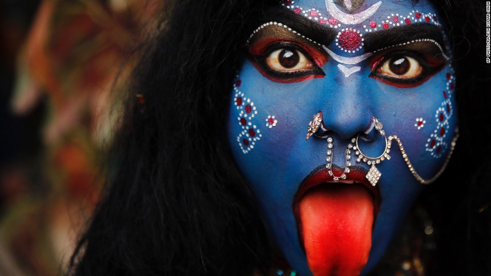 FEBRUARY 28 - ALLAHABAD, INDIA: A woman dressed as Hindu goddess Kali participates in a Shivaratri procession. The night is dedicated to the worship of Lord Shiva, the Hindu god of death and destruction. Kali is represented as the consort of Shiva.