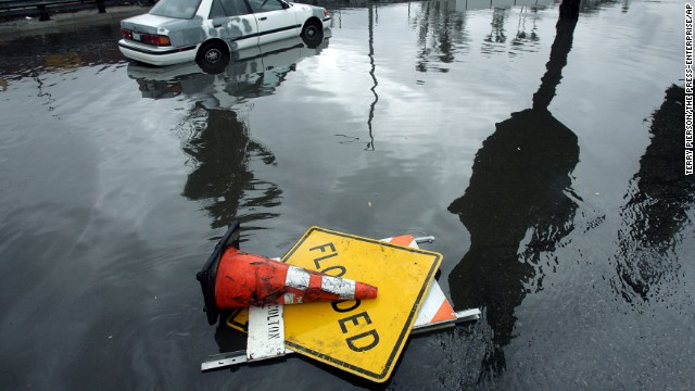 A car sits stalled in flood waters in Colton, California, on February 28.