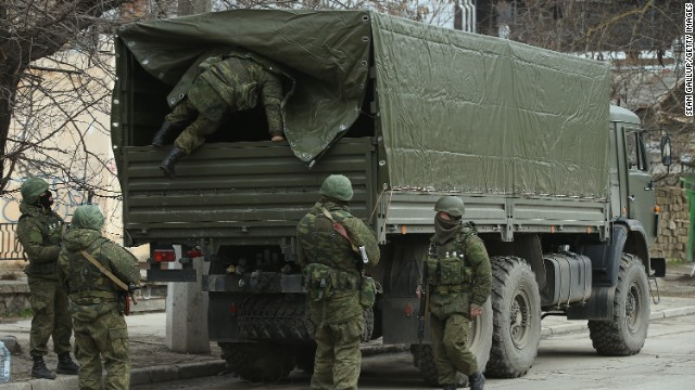Heavily armed soldiers displaying no identifying insignia maintain watch in Simferopol, Ukraine, on March 1.