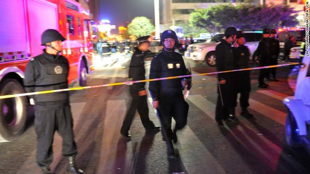 Police gather near the scene of the attack.