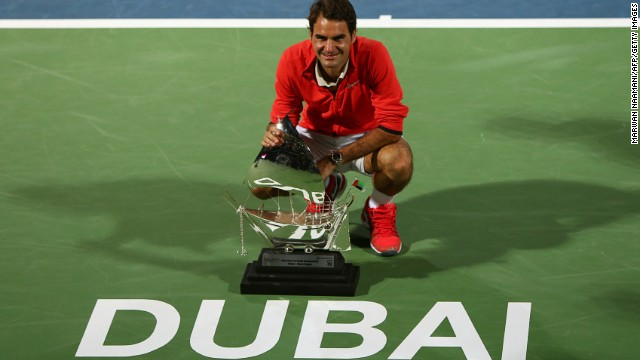 Roger Federer poses for photographers after clinching a sixth Dubai title on Saturday.