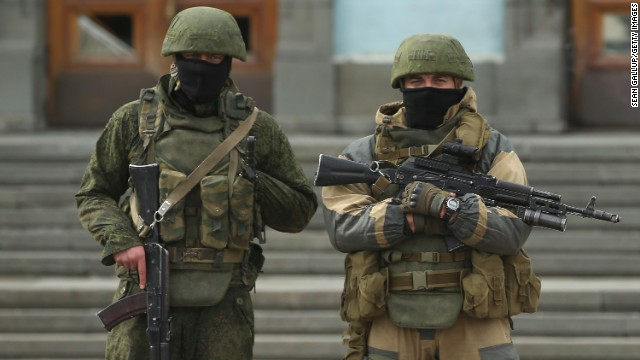 Heavily armed troops, displaying no identifying insignia and who were mingling with local pro-Russian militants, stand guard outside a local government building in Simferopol, Ukraine, on March 2.