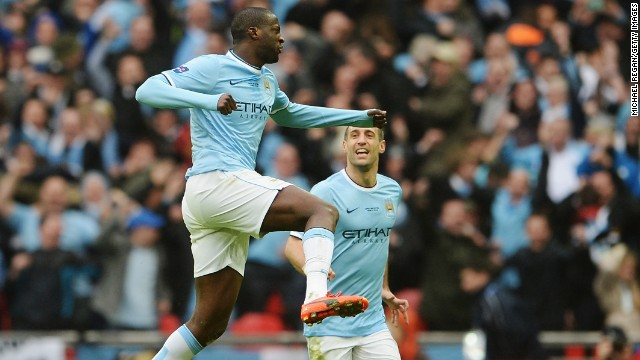 Yaya Toure punches the air in celebration after scoring Manchester City's equalizer at Wembley.