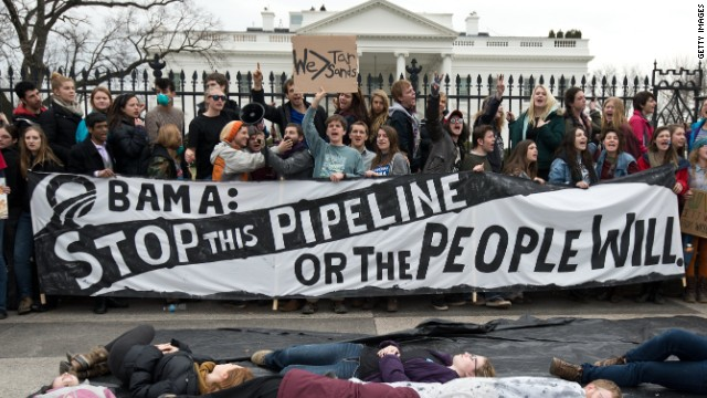 Keystone pipeline foes create 'human oil spill' at rally; hundreds arrested