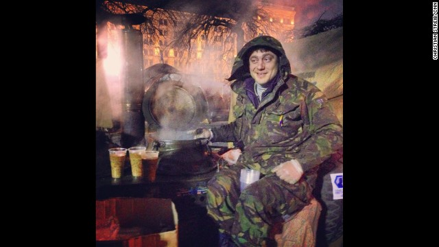 "KIEV, UKRAINE: ""27-year old Bogdan sits on top of his Russian-made soup kitchen in Indepence -- or Maidan -- Square on March 2. He's been sitting there for the last three months serving delicious Ukrainian grechaniy soup. It's made of buckwheat, lentil, coriander and beef. Amazing taste."" - CNN's Christian Streib. Follow Christian on Instagram at <a href='http://instagram.com/christianstreibcnn' target='_blank'>instagram.com/christianstreibcnn</a>."