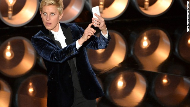 DeGeneres <a href='https://twitter.com/TheEllenShow/status/440302561044594688' target='_blank'>takes a selfie</a> on stage near the start of the show.