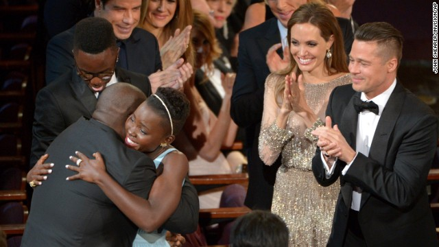 "Lupita Nyong'o hugs McQueen after winning best supporting actress for her role in ""12 Years a Slave."""