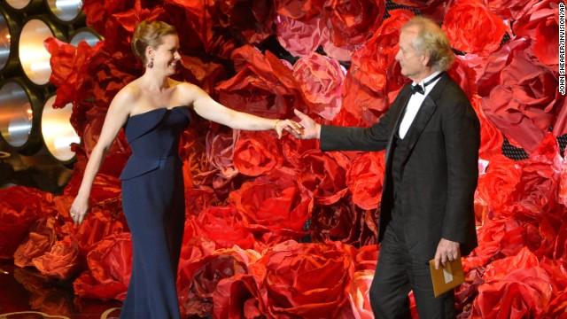 "Amy Adams greets Bill Murray on stage. While reading the names of those nominated for best achievement in cinematography, Murray also mentioned director <a href='http://www.cnn.com/2014/02/24/showbiz/movies/obit-harold-ramis/index.html'>Harold Ramis</a>, his ""Ghostbusters"" co-star who died last month at the age of 69."