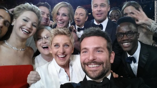 "Academy Awards host Ellen DeGeneres takes a moment during the show to orchestrate a selfie with a group of stars. Bradley Cooper, seen in the foreground, was holding the phone at the time. ""If only Bradley's arm was longer,"" DeGeneres tweeted. ""Best photo ever."" It reportedly became the most retweeted post of all time."