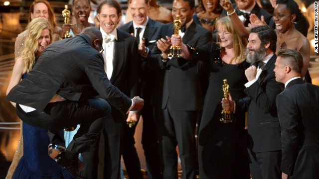 "Director Steve McQueen, left, celebrates with the cast and crew of ""12 Years a Slave"" as they accept the Academy Award for best picture on Sunday, March 2."