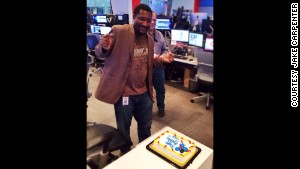 Mungin celebrates his 41st birthday in the CNN newsroom after returning to work from brain surgery.
