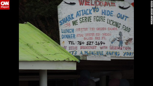 """Several mental images came to mind, none very appetizing,"" when Robert Tanner saw <a href='http://ireport.cnn.com/docs/DOC-1096486'>this sign</a> for ""figure licking"" food at a restaurant on Chatham Bay, Union Island, in the Grenadines."