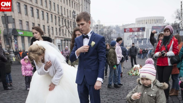 """Most weddings in Kiev now find their way to Maidan, as newlyweds come to give their gratitude and give honor to the heroes,"" Mikhaluk said."