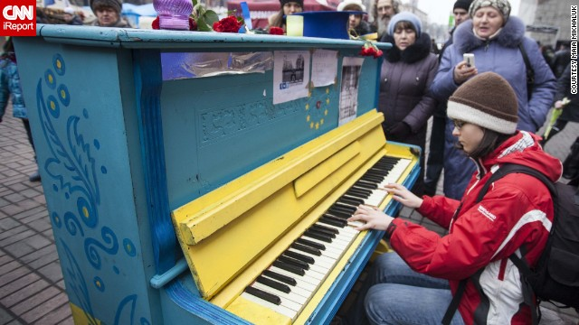 A young girl plays <a href='http://ireport.cnn.com/docs/DOC-1098749'>piano</a> in downtown Kiev 10 days after protests there.