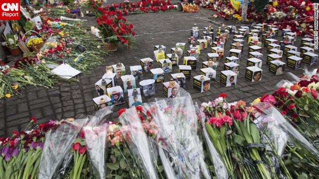 """People are still coming with <a href='http://ireport.cnn.com/docs/DOC-1098749'>flowers</a> and grieving for the heroes who laid their lives for free Ukraine. The streets are like rivers of flowers,'"" Mikhaluk said."