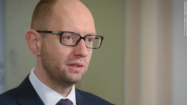 "Ukrainian Prime Minister Arseniy Yatsenyuk: Ukraine's interim prime minister has urged Russia to pull back its military, warning that the two countries were ""on the brink of disaster."" The comments came as a convoy of Russian troops rolled toward Simferopol, the capital of Crimea, a day after they took over the strategic Black Sea peninsula without firing a shot. ""There are no grounds for the use of force against civilians and Ukrainians, and for the entry of the Russian military contingent,"" Yatsenyuk said. ""Russia never had any grounds and never will."""