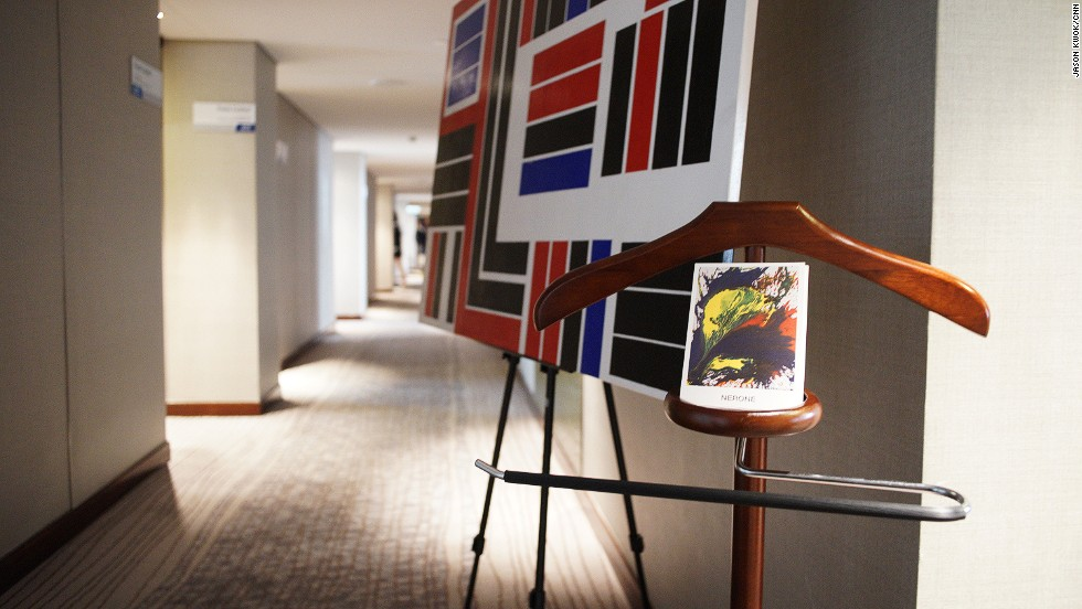 The Asia Hotel Art Fair 2014 used the Marco Polo Hongkong Hotel last weekend to exhibit artworks. Prices on pieces displayed ranged from $200 to $1 million. A Diamante Galasso painting and Nerone postcards from Gallery Koo greeted customers in this corridor.