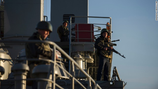 Ukrainian seamen stand guard on the Ukrainian navy ship Slavutich in the Sevastopol harbor on Monday, March 3.