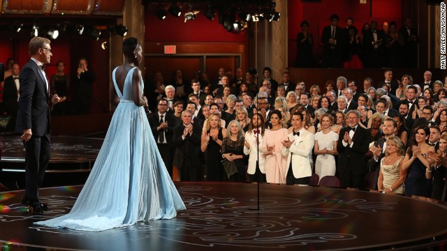 "MARCH 3 - LOS ANGELES, UNITED STATES: Lupita Nyong'o receives a standing ovation as she accepts the award for best actress in a supporting role for <a href='http://cnn.com/2014/03/02/showbiz/movies/oscars-2014/index.html?hpt=hp_c3'>""12 Years a Slave""</a> during the Oscars at the Dolby Theatre on March 2. The drama was named best picture at the 86th Academy Awards."