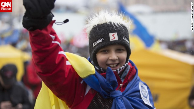 A young Ukrainian boy cheers in support of his country.