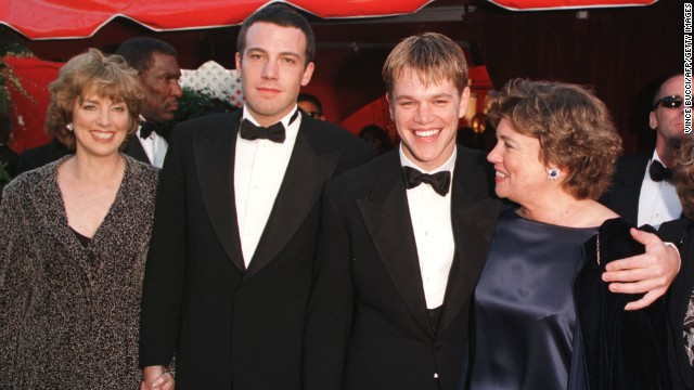 "Ben Affleck, second from left, arrives with his mother, Chris Boldt, and Matt Damon, third from left, arrives with his mother, Nancy Carlsson-Paige, at the 70th Annual Academy Awards on March 23, 1998, in Los Angeles. Affleck and Damon won the award for Best Original Screenplay for ""Good Will Hunting."" Damon was nominated for Best Actor for the same film."