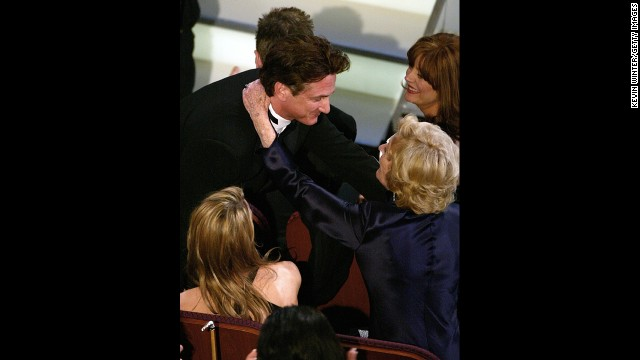 "Sean Penn hugs his mother in the audience after winning the award for Best Performance by an Actor for ""Mystic River"" during the 76th Annual Academy Awards on February 29, 2004, in Hollywood, California."