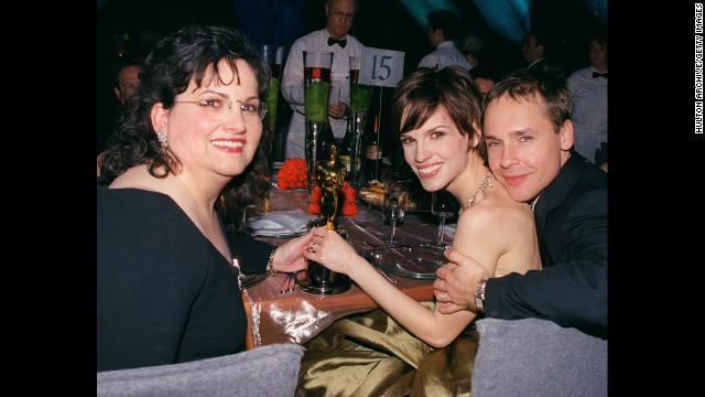 "Hilary Swank, center, with her mother and then-husband Chad Lowe, shows off the Best Actress Oscar she won on March 26, 2001, for her performance in ""Boys Don't Cry."""
