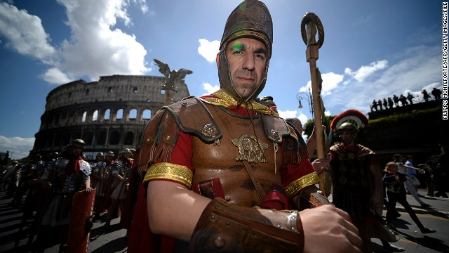 Men dressed as ancient Romans march in the Italian capital to mark the anniversary of the Coliseum on April 21, 2013.