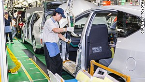 At Toyota\'s Motomachi plant, visitors watch production from a series of bridges overhead.