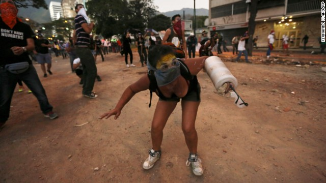 A protester in Caracas ducks during clashes with police on March 3.