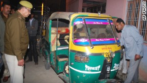 Police inspect the rickshaw of Bunty Sharma, after he killed his wife and blew himself up at home.