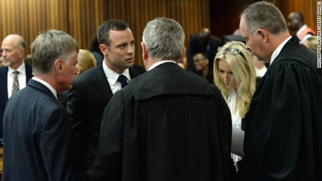 Pistorius speaks with his legal representatives on March 4.
