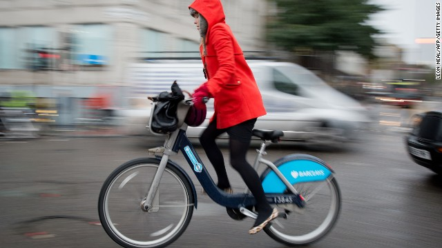 A cyclist rides a public hire