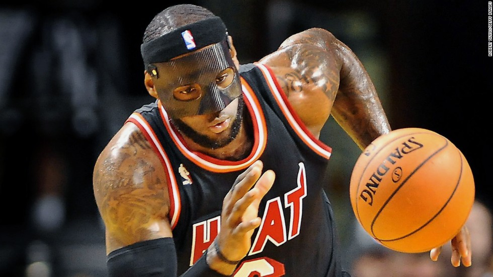 LeBron James wears a mask to protect his broken nose as the Miami Heat play against the New York Knicks in Miami on Thursday, February 27.