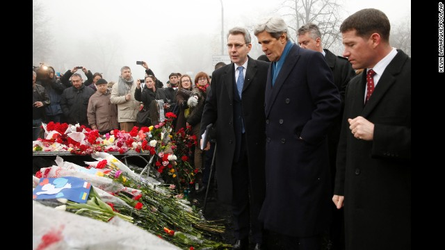 U.S. Secretary of State John Kerry, wearing a blue scarf, visits a shrine March 4 for the people who were killed during anti-government protests in Kiev last month.