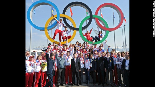 Putin, center, poses for a photo with Russian Olympic athletes in Sochi, Russia, on February 24. Russia hosted the Olympic Games and won the most medals.