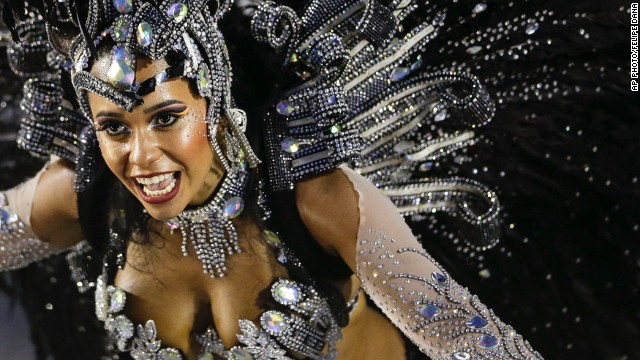 MARCH 4 - RIO DE JANEIRO, BRAZIL: A performer from the Beija-Flor samba school parades during carnival celebrations at the Sambadrome -- a competition between dance schools -- on March 3. <a href='http://cnn.com/video/data/2.0/video/world/2014/03/03/wbt-pkg-darlington-brazil-rio-carnival.cnn.html'>Watch as CNN's Shasta Darlington follows the colorful procession. </a>