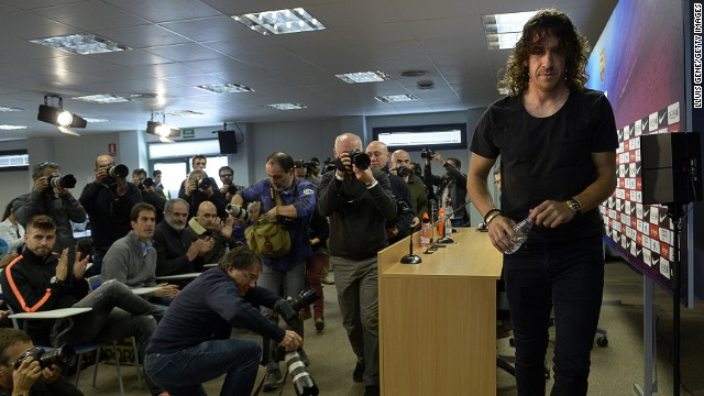 Gerard Pique (left) claps Carles Puyol off as the club captain announces an end to his time at Barcelona.