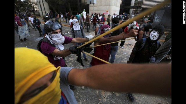 Protesters use a giant slingshot to launch stones at police during clashes in Caracas on Monday, March 3.