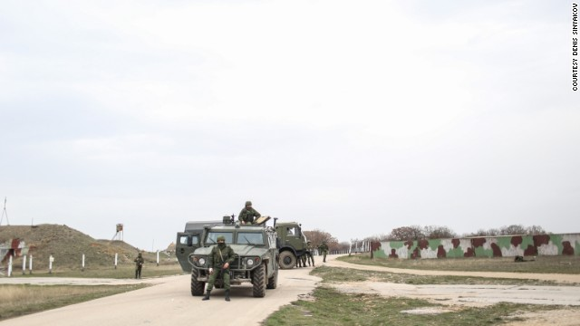 Russian soldiers stand guard at the Belbek air base on March 4.