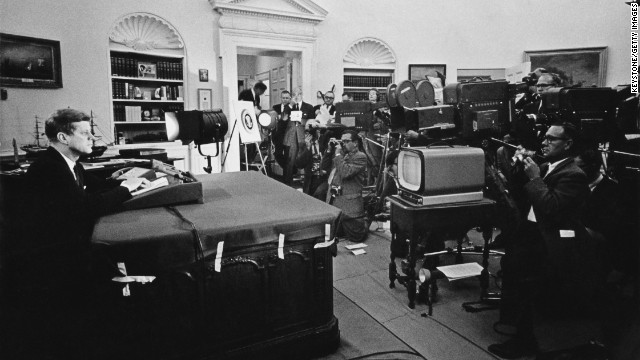 U.S. President John F. Kennedy delivers a nationally televised address about the Cuban missile crisis on October 22, 1962. After learning that the Soviet Union had begun shipping missiles to Cuba, Kennedy announced a strategic blockade of Cuba and warned the Soviet Union that the U.S. would seize any more deliveries.