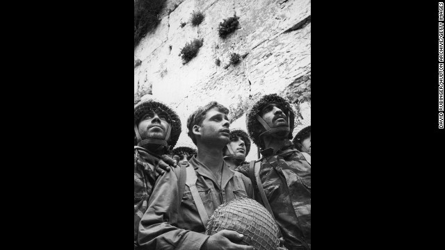 On June 5, 1967, Israel launched an attack that becomes known as the Six Day War, seizing the Sinai and Gaza Strip from Egypt, the West Bank and East Jerusalem from Jordan and the Golan Heights from Syria. The Soviet Union accused the United States of encouraging Israeli aggression. Here, several Israeli soldiers stand close together in front of the Western Wall in the old city of Jerusalem following its recapture.