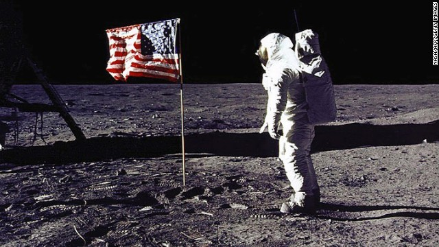 "Edwin ""Buzz"" Aldrin, Armstrong's fellow astronaut on Apollo 11, salutes the U.S. flag on the lunar surface. Aldrin followed Armstrong and became the second man to walk on the moon."