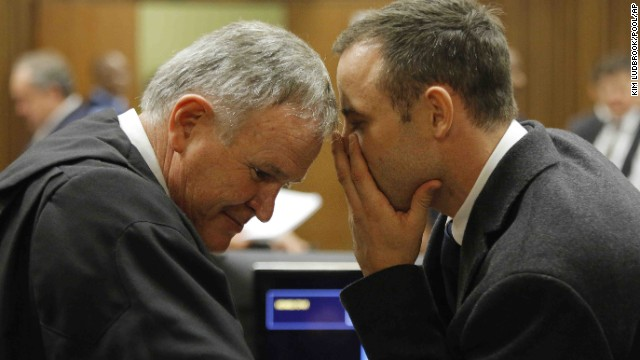 Pistorius talks with his attorney, Barry Roux, inside the court on March 4.