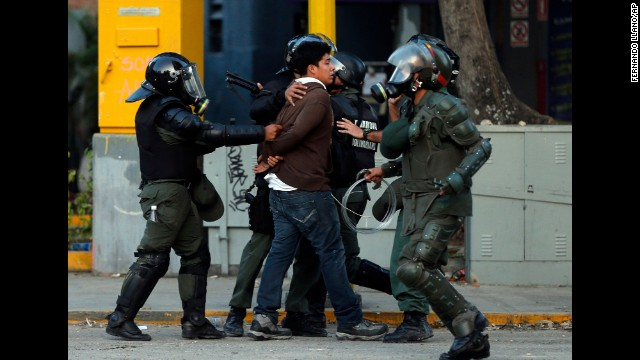 Bolivarian National Guard officers detain a protester on March 4 in Caracas.