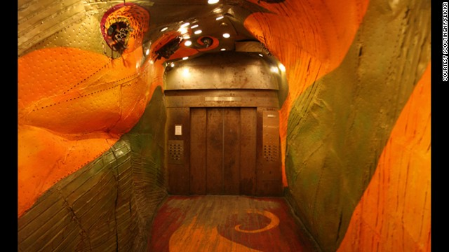 The red dragon painted on the interior of this elevator in the Long Island City Business Center building has 3-D beasts bursting from its eye sockets.
