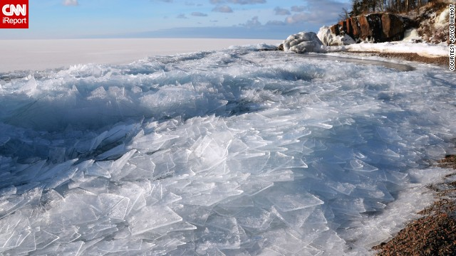 Along the shore of <a href='http://ireport.cnn.com/docs/DOC-1040914'>Lake Superior</a>, you can almost hear the the sound of frozen waves crack on the shore as the lake's current breaks up the sheets of ice.